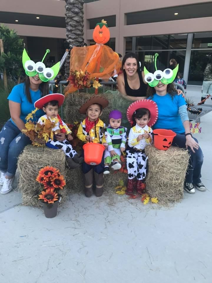 Family Dressed in Toy Story costumes posing