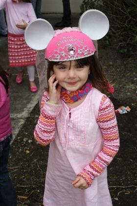 Girl wearing a pink hat with ears