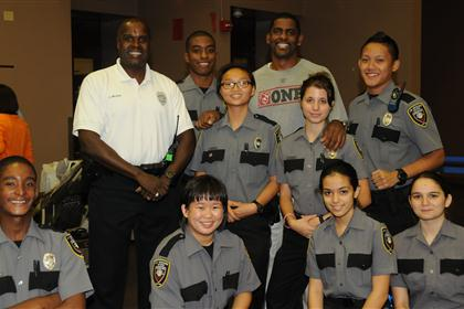 Officer Wilson and police explorers from Pines Night Out 2012