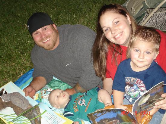 Family reading under the stars