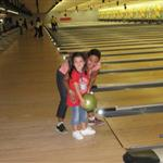 Camper receiving help bowling
