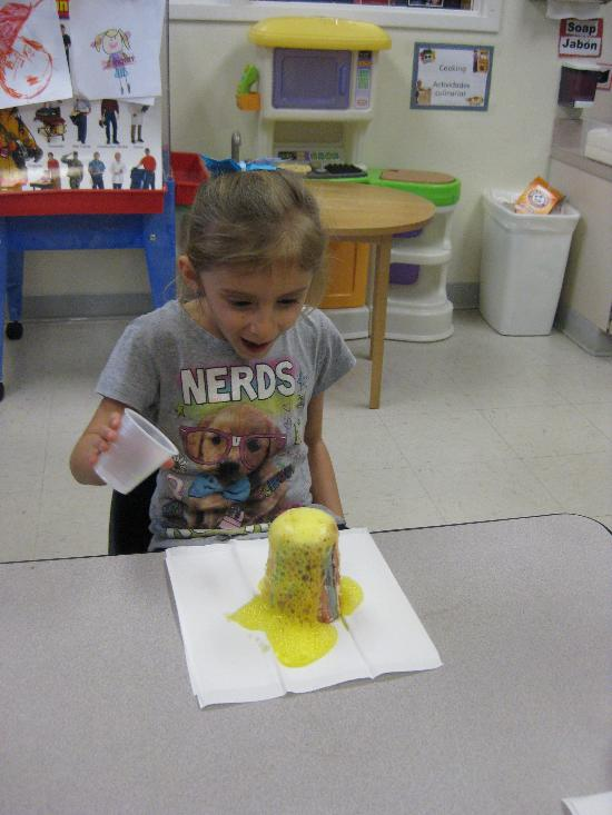 Girl making a volcano