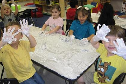 Children getting messy with arts and crafts