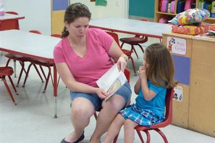 Lady reading to child